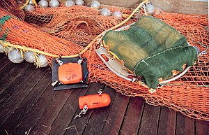 Fishing trawler - A net mensurations system using acoustic sensors which measure the depth and opening of the trawl net.