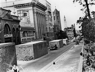 Ann Street, Brisbane - Air raid shelters on Ann Street, 1942; the Masonic Temple, Shell House, St Andrew's Uniting Church, and the tower of City Hall on the left