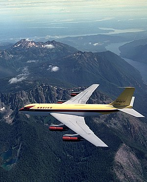 Boeing 367-80 - The Dash 80 overflying the Olympic Peninsula, Washington, with Mt. Rainier in the background.