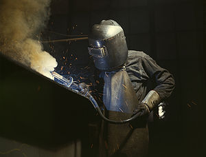 Blue-collar worker - Welder making boilers for a ship, Combustion Engineering Company. Chattanooga, Tennessee, June 1942. Despite their name, blue-collar workers don't always or typically wear blue shirts.