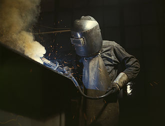 United States home front during World War II - Welder making boilers for a ship, Combustion Engineering Co., Chattanooga, Tennessee. June 1942.