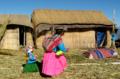 Amerindian woman babywearing on lake titicaca.png