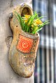 Amsterdam flowers in a shoe (6162709784).jpg