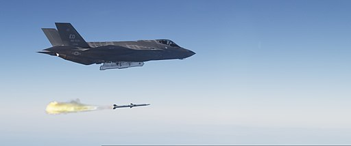 An F-35A Lightning II aircraft launches an AIM-120 advanced medium-range air-to-air missile over a military test range off the California coast Oct. 31, 2013 131031-N-ZZ999-110