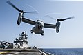 An MV-22 Osprey lifts off from the flight deck of USS America during flight operations. (37495778171).jpg