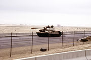 An abandoned Iraqi Type 69 tank on the road into Kuwait City during the Gulf War