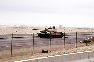 English: An abandoned Iraqi Type 69 main battl...