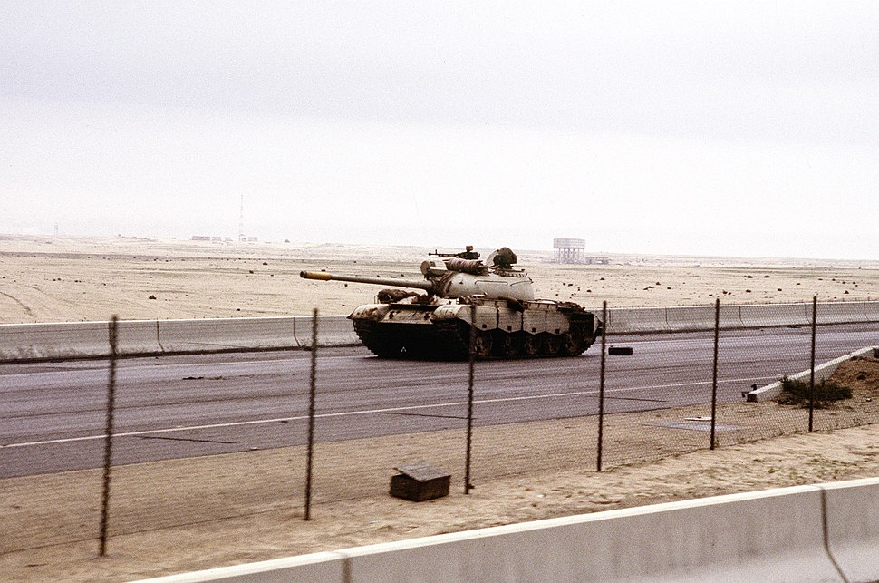 An abandoned Iraqi Type 69 tank on the road into Kuwait City during the Gulf War.JPEG