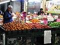 An elderly Chinese gent examines mandarin oranges in Toronto's Chinatown (27899779285).jpg