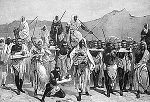 Arab slave trade - A 19th-century European engraving of Arab slave-trading caravan transporting African slaves across the Sahara.