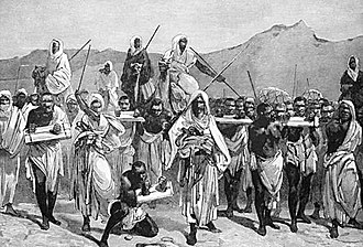 Arab slave trade - 19th-century engraving depicting an Arab slave-trading caravan transporting black African slaves across the Sahara.