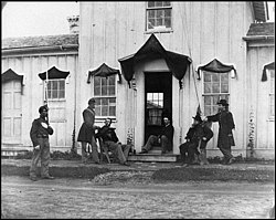 Arlington, Va. Capt. Nevins and officers in front of headquarters, Fort Whipple; mourning crepe drawn over doors and windows LOC cwpb.03813.jpg