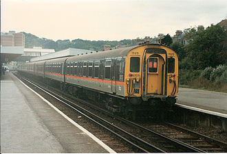 Southern Region of British Railways - A 4 CEP electric multiple unit in Jaffa Cake livery on the 1066 electric service to Hastings in 1986.