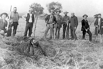 Battle of Stone Corral - The wounded John Sontag lying next to the possemen.