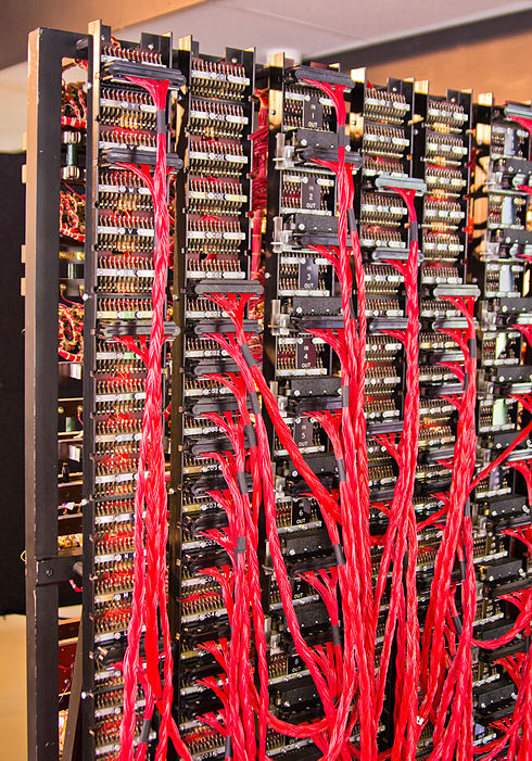 Rear view of the rebuilt Bombe. This shows the patch panels and 26-way cables used to wire up the 'menus'. It includes the 'diagonal boards' which, despite their name, are physically rectangular. Bletchley Park Bombe8.jpg