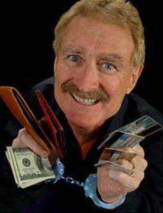 Bob Arno - Bob Arno, handcuffed, with cash, wallets, and credit cards.