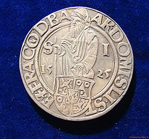 Thaler - The 1525 Joachimsthaler of the Kingdom of Bohemia was the first thaler. The obverse side pictures St Joachim.