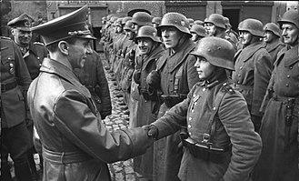 Upper Silesian Offensive - Joseph Goebbels awards 16-year-old Hitler Youth member Willi Hübner the Iron Cross for the defense of Lauban (Lubań).