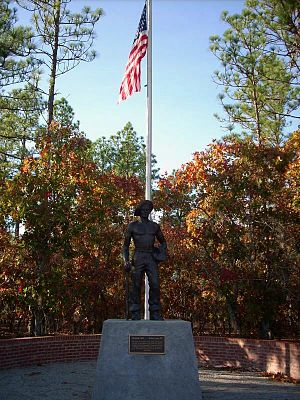 Singletary Lake State Park - The CCC Statue is surrounded by turkey oak and longleaf pine trees.