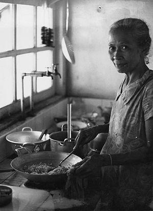 Nasi goreng - A woman cooking nasi goreng in Indonesia.