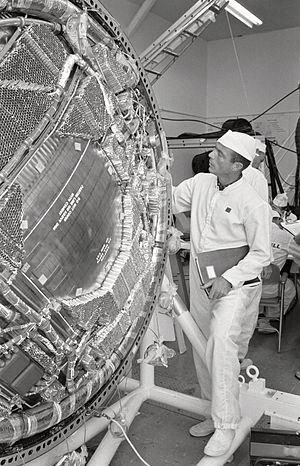 Scott Carpenter - Carpenter inspects the honeycomb material that will support the protective heat shield of his Aurora 7 spacecraft in 1962.