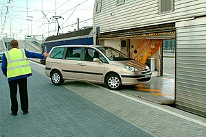 Eurotunnel Shuttle - A Peugeot 807 entering a shuttle wagon at the French terminal at Coquelles near Calais in northern France