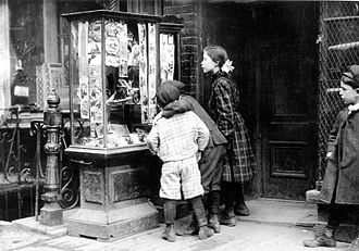 Christmas card - Children looking at Christmas cards in New York  1910