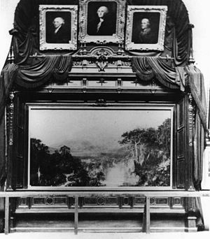 The Heart of the Andes - There is no photographic record of the 1859 exhibition of The Heart of the Andes; its exhibition in 1864 is pictured. The overhanging portraits and handrails were added for its inclusion in the fine art gallery at New York's Metropolitan Sanitary Fair.