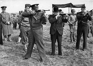 Edward H. Brooks - Brooks observing General Dwight D. Eisenhower, Winston Churchill and Lieutenant General Omar Bradley fire M1 carbines.