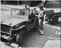 Civilian Photo Technicians (in back of jeep) working for Counter Intelligence Corps, are accounted for by Captain... - NARA - 198977.tif
