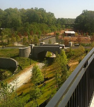 Piedmont Park - Looking south, new bridge over Clear Creek in the new section of the park, with the new dog park in the background