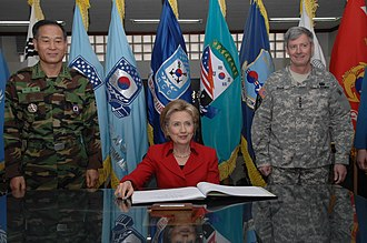 Yongsan Garrison - Secretary of State Hillary Clinton visits USAG-Yongsan 20 February 2009. The Combined Forces Command (CFC) Commanding General Walter Sharp (right) and his deputy, Gen. Lee Sung-chool (이성출, left), welcomed the secretary.