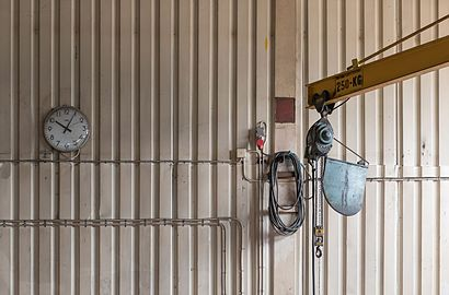 Clock and indoor crane with lifting hook.jpg