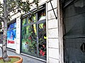 Closed shop with decorated windows in Rome.jpg