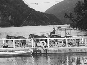InterCity (New Zealand) - Image: Cobb and Co coach on board a punt on the Buller River (21120308819) (cropped)