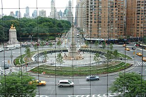 Traffic circle - Columbus Circle in New York City. Unlike a modern roundabout, the circle is quite large and pedestrians have access to the center island. Access is controlled by traffic lights.