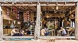 Craftmen at work, bamboo basket weaving and textile mobile sculptures, in Heuan Chan heritage house, Luang Prabang, Laos.jpg