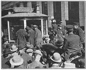 Indianapolis streetcar strike of 1913 - A crowd of strikers surrounds and boards a streetcar being protected by mounted police