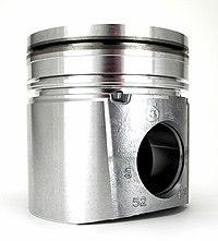 https://upload.wikimedia.org/wikipedia/commons/thumb/5/55/Cummins_Diesel_engine_piston_head_45deg_%28cropped%29.jpg/200px-Cummins_Diesel_engine_piston_head_45deg_%28cropped%29.jpg