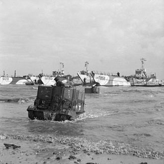 231st Brigade (United Kingdom) - Universal Carriers of 50th Division wade ashore from LCTs on Jig beach, Gold area, 6 June 1944. The markings on the carrier indicate a vehicle from the 1st Battalion, Dorsetshire Regiment, 231st Brigade.