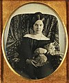Daguerreotype of woman holding cat.jpg