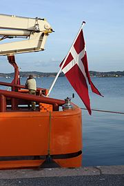 Danish flag at stern of ship Gunnar Thorson.jpg