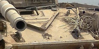 Lion of Babylon (tank) - Image showing the plate of laminated armor welded on the glacis of a T-72. Note the edges around the rectangular section of the towing eyes and driver's hatch.