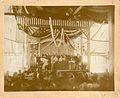 Description- Fourth of July celebration. Concert with view of a stage with people singing and a woman playing the piano. Photographer- Jessie Tarbox Beals (14379457387).jpg