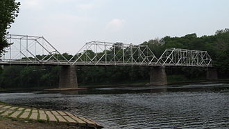 The Dingman's Ferry Bridge connecting Sandyston Township, in Sussex County, New Jersey and Delaware Township in Pike County, Pennsylvania is the last privately owned toll bridge on the Delaware River and one of the last few in the United States. DingmansFerryBridgeSide.jpg