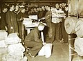 Distributing papers on mail day on board HMS Royal Oak (21332829639).jpg