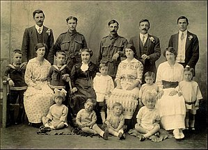 George Doig - A photograph of the Doig family taken in 1915, with George Doig middle row, third from right.