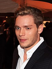 Portrait of English actor Dominic Sherwood, notably his eyes with different colors: his left eye is brownish blue, while his right eye is clear blue