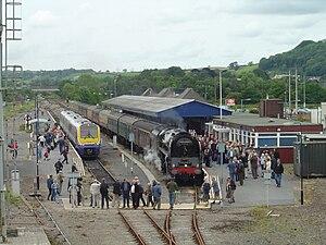 Dieselisation - Modern diesel multiple unit next to a steam locomotive at Carmarthen railway station in 2007