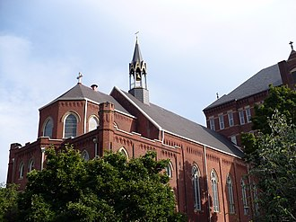 "Duquesne University - The Duquesne University chapel adjoins the ""Old Main"" administration building."